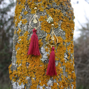 red earrings sagra potenciano