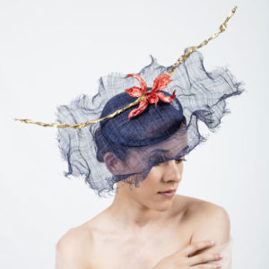 navy fascinator with red orchid